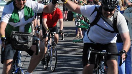 Riders cross the finish line in Ilfracombe during the 10th anniversary Devon Coast 2 Coast cycle cha