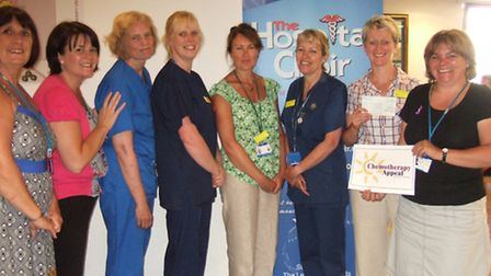 Members of the Hospital Choir present a cheque for £2,622.85 to Chemo Appeal fund raiser Julie Whitt