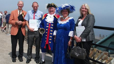 The South West in Bloom judges Rod Poole and Alison Wells (far right) pictured on the seafront with