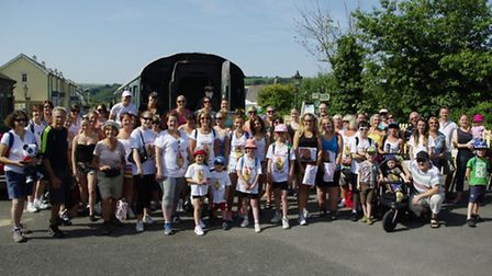 The walkers gather before setting off along the Tarka Trail from Bideford to Barnstaple, to help rai