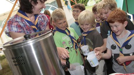 Beaver leader Helen Murphy is seen about to use the boiler to supply drinks for eager scouts on camp