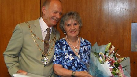 Council Chairman Geoffrey Fowler presented Councillor Faye Webber with flowers and a special book fo