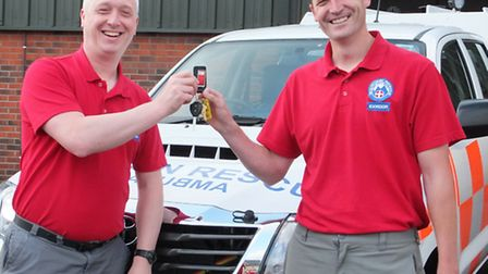 Jim Whatley, team leader receives the keys from Dan Paton ,projects leader.