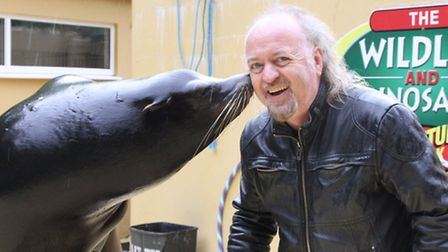 Bill Bailey receives a big wet smacker from one of the park sea lions.