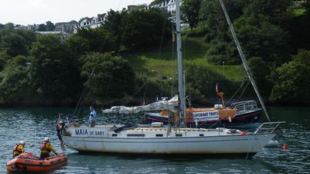 The D-class inshore lifeboat giving aid to the yacht Maia of Dart, in the outer harbour at Ilfracomb