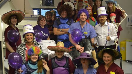Hospital radiology staff pose for a picture after their Harlem Shake session to raise money for the