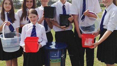 Year nine pupils at Pilton Community College with a biosand water filter.