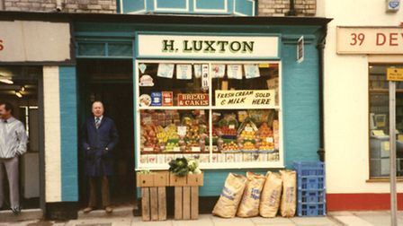 Henry Luxton stood outside of H. Luxton, the shop he was so proud of.