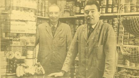 Henry Luxton (right) and his father, Henry Luxton, in the shop.