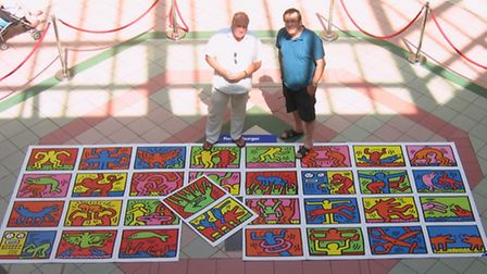 Dave Butt and Steve Warner at Green Lanes Shopping Centre in Barnstaple with a cardboard template of