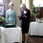 Lady Arran (left) and Gilly Drummond cutting the cake.