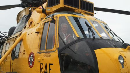 Mayor of Northam Barry Mason tries out the Sea King for size at RMB Chivenor.