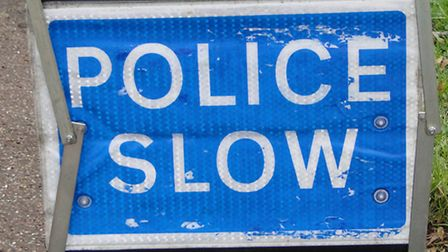 ndg-police-slow-sign-wk31