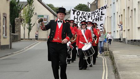 The rally made its way towards the hospital led by the town crier and town band.