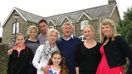 Chris Palmer and his wife Ruby (centre) surrounded by (from left) grand-daughter Daisy, son Tim and