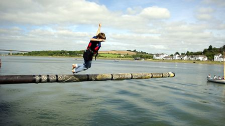 Taking on the greasy pole at Bideford water festival 2013. Pic: Graham Hobbs.