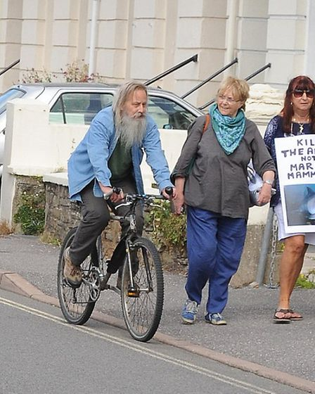 The man pictured on the bicycle was later ejected from the public meeting at the Park Hotel. Pic by