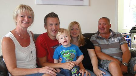 Jenson Tucker with parents Joel and Carly Tucker and grandparents Anna and Buster Jones.