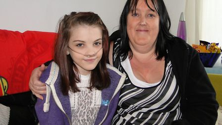 Teenager Katie Gammon, pictured last October with mum Angie Hart, is recovering after her double lun