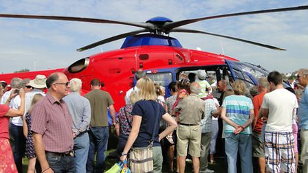 People in Braunton take the opportunity to get a good look at the new Devon Air Ambulance helicopter