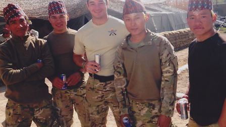 Lieutenant Edward Drummond-Baxter of 1st Battalion Royal Gurkha Rifles pictured with troops in Afgha