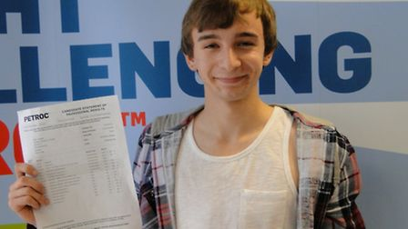 Iain Sharp was delighted after discovering he had achieved three A* grades when he went along to Pet