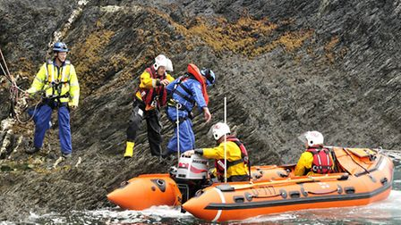 The RNLI inshore lifeboat Deborah Brown and Coastguard volunteers carry out a simulated cliff rescue