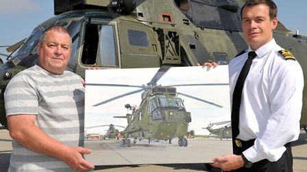 Tony Byrne presenting his painting of Sea King ZA298 to 845 NASs executive officer, lieutenant comma