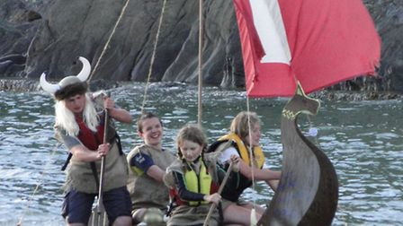 Watery mayhem from Sunday's Combe Martin Carnival raft race. Pictured are junior winners The Brine S