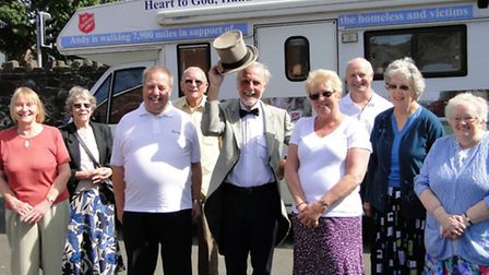 Intrepid walker Andy Peddle (centre) with Vincent Hall and well wishers at Barnstaple Salvation Army