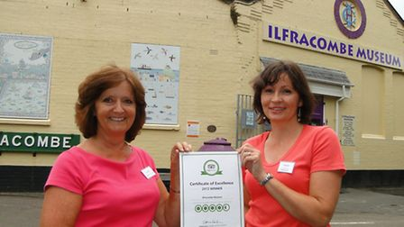 Volunteer Eve Galliver and manager Sara Wilson outside Ilfracombe Museum with the TripAdvisor certif