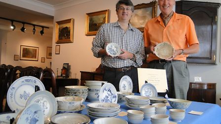 Jonathan and John Biggs with the collection of china pulled from the Tek Sing.