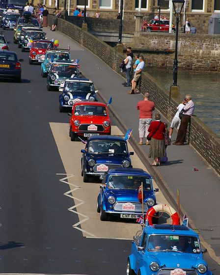 The Minis make their way over the old bridge in Bideford on Sunday. Picture: Graham Hobbs Photograph