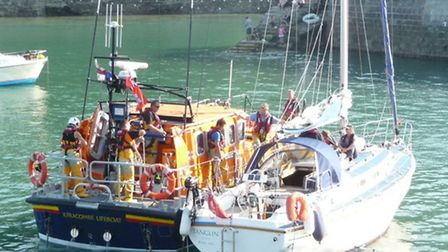 The Ilfracombe all weather lifeboat brings the yacht Tanglin safely into Ilfracombe Harbour. Picture