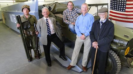 Pictured with the replica landing craft are Robert Endean of living history group First Wave '44, Ro