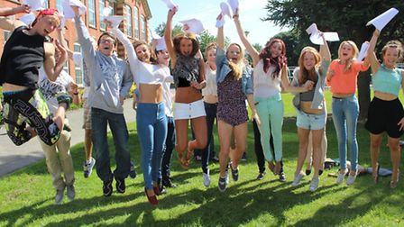 A delighted group of students from Park School leap with joy