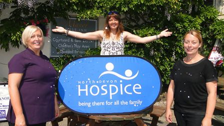Lyn Barefoot, Emma Lowe of the North Devon Hospice and Lindsay Creely of The Manor get into the wedd