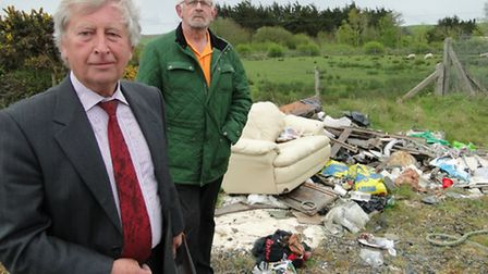 Councillors Rodney Cann and Chris Turner at the site of some of the fly tipping on the Yelland power
