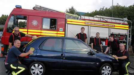 Fire fighters in Holsworthy soaped down cars for cash to raise more than £200.