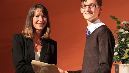 Jamie Crawford is presented with his award for achieving four A* grades at A level, by Ilfracombe he