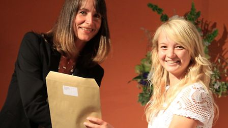 Albany Bradley, now in Year 12 at the Ilfracombe Academy, receives her award from headteacher Sharon