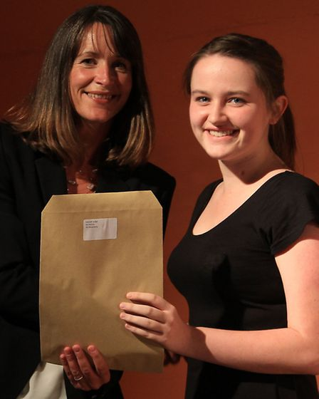 Hannah Judge, now in Year 13, receives her award from headteacher Sharon Marshall for her achievemen