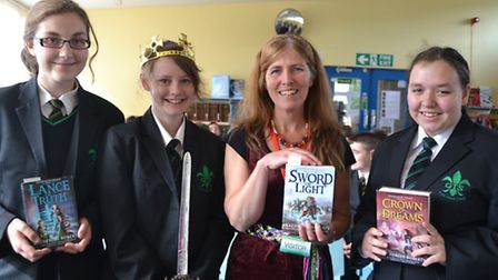 Author Katherine Roberts pictured with students Eleanor Mann, Katie Smith and Shannon Hughes.