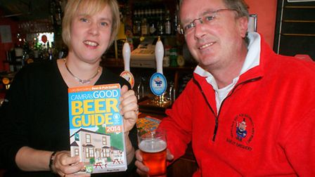 Reform Inn landlady Esther Davies and Barum Brewers Tim Webster toast their inclusion in CAMRAS Good