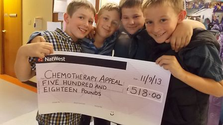 Liam Stanton, Lewis Stanton, Marcus Northcott and Alfie Harris pictured delivering their cheque for