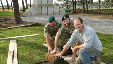 Laying the final turf for the formal area of the new Chivenor Memorial Garden are Lieutenant Colonel
