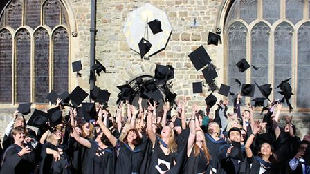Petroc degree students celebrate their graduation in the traditional manner on Saturday outside St P