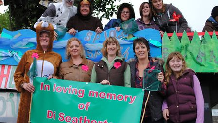South Molton Pre-school staff are pictured with their memorial banner for Di Seatherton. Picture by
