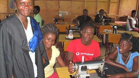 The tailoring students at Kira Farm Training Centre in Uganda making the gowns for Petroc.