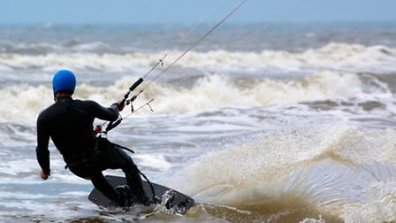 A kitesurfer was taken to hospital after being blown into sand dunes at Northam Burrows. Picture for